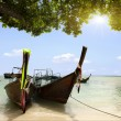 Thai boat on a sandy beach - Stock Photo