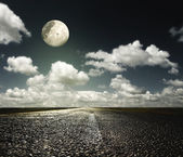 Asphalt road and the moon — Stock Photo