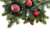Christmas background with balls and decorations isolated on whit — Stock Photo