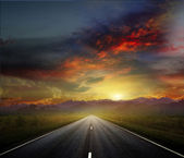 Country road with a dark sky — Stock Photo
