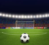Green soccer field, bright spotlights, — Stock Photo