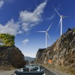 Stock Photo: The road, windmills and mountains