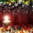 Four red candles with christmas balls in atmospheric light — Stock Photo