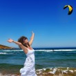 Woman and the sea — Stock Photo #38637365