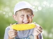 Boy with corn — Stock Photo