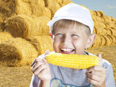 Boy with corn — Stock Photo