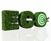 Eco word composed by grass with a dartboard and darts — Stock Photo
