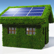 Stock Photo: Grassy house with solar panels