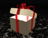 Semi-open gift box with red ribbon and bow — Stock Photo