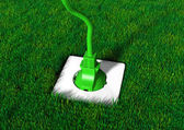 Plug into a grassy ground — Stock Photo