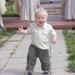 Stock Photo: Happy little boy is running