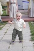 Happy little boy is running — Stockfoto
