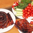 Grilled ribs and sausages with vegetables — Stock Photo #14699171