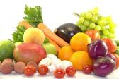Fresh fruits and vegetables on white background — Stock Photo