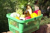 Fresh food in a plastic basket — Stock Photo