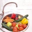 Stock Photo: Fruits and vegetables on kitchen