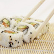 Sushi - California rolls with salmon on white background — Stock Photo