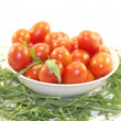 Delicious baby tomatoes and rocket in the plate isolated on white — Stock Photo #24847503