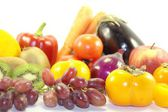 Fresh tasty fruits and healthy vegetables on white background — Stock Photo