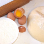 Dough, cake flour and eggs for baking — Stock Photo