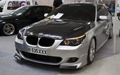 White pink colored BMW seria 5 at the 4Tuning Fest Auto Show Bucharest, Romania — Stock Photo