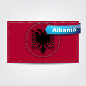 Fabric texture of the flag of Albania — Stock Vector