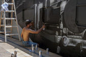 Bucharest, Romania - June 29, 2013: A young graffiti artist dur — Stock Photo