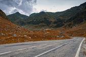 Grunge mountain road in autumn — Stock Photo