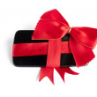 Stock Photo: Smart Phone with Red Ribbon and Bow isolated