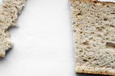 Cutted and ripped bread background — Stock Photo