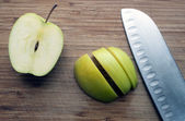 Large knife on a wooden board — Stock Photo