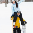 Young man and woman with treir snowboards - Stock Photo