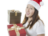 Showing christmas gifts — Stock Photo