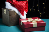 Santa hat and gift boxes — Stock Photo