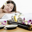 Relaying young adult at spa treatment — Stockfoto