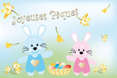 Little Easter bunnies and Easter eggs in basket — Stock Vector