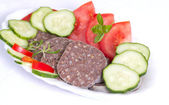 Breakfast of traditional black pudding and tomatoes. — Stock Photo