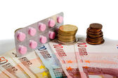 Medicines and money — Stock Photo