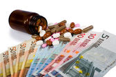 Medicines and money — Stock Photo