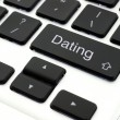 Dating button on laptop — Stock Photo