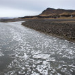 Stock Photo: Floating ice on river