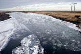 Floating ice on river — Stock Photo