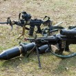 Automatic weapons on ground - Stock Photo