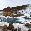 Waterfall in pingvellir valley - Stock Photo