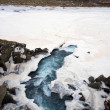 Stock Photo: Waterfall near pingvellir valley