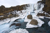 Waterfall in pingvellir valley — Stock Photo