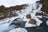 Waterfall in pingvellir valley — Stock Photo