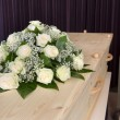Stock Photo: Flower arrangement on coffin