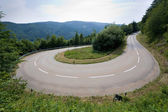 Hairpin in alps — Stockfoto