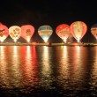 Stock Photo: Nightglow with hot air balloons